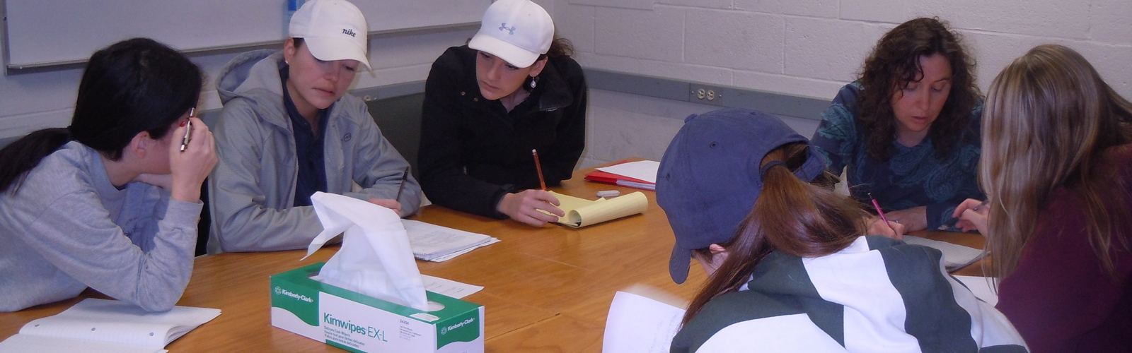Students helping one another and working with an instructor