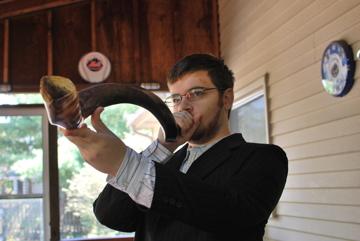 A man blowing the shofar